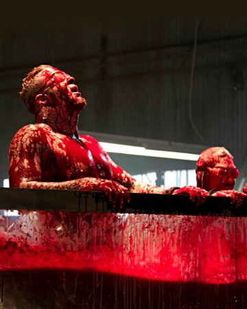 Fear Factor - Cow blood tub