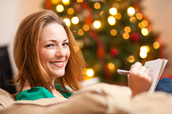 Woman writing to do list for holidays