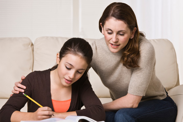 Helicopter mom helping teen daughter with homework