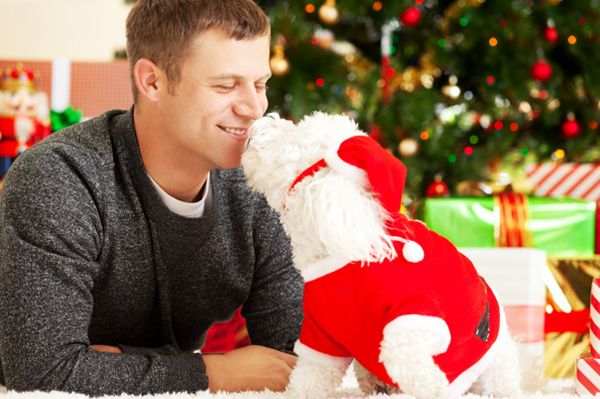 Man with rescued dog on Christmas