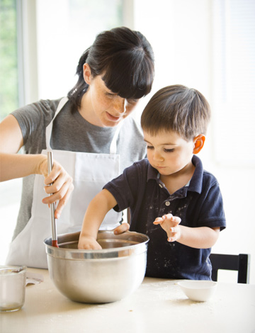 Mom making puppy chow with son