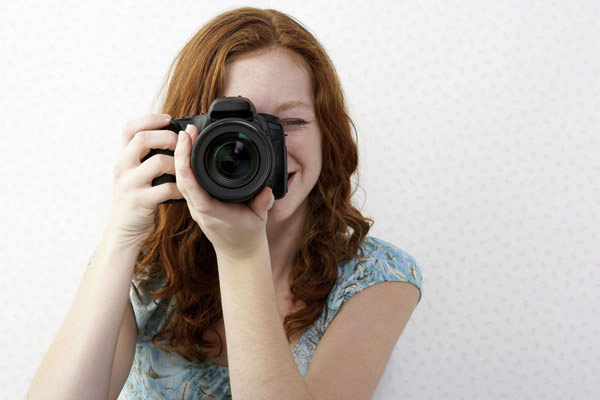 Woman with DSLR camera