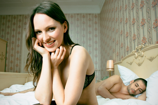 Happy woman in bed with boyfriend