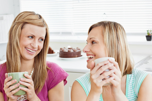 Relaxed party host chatting with friend