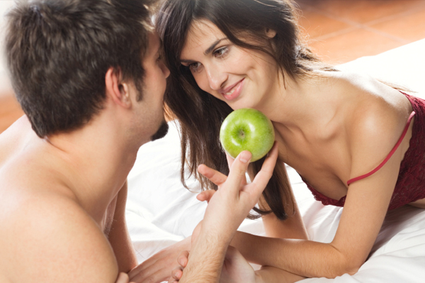 Sexy couple in bed with apple