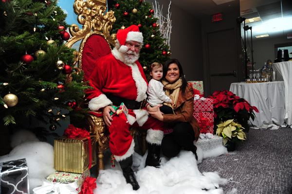Tiffani Thiessen and Harper with Santa