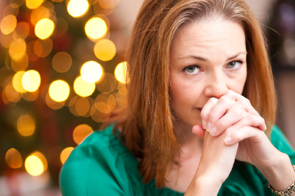 Depressed woman at holiday table