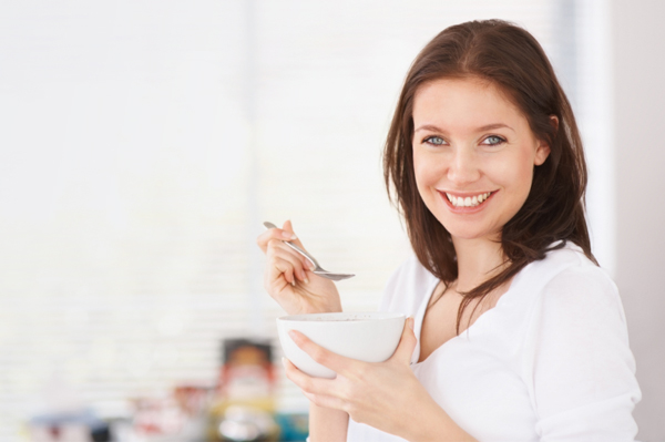 Woman eating steel cut oatmeal