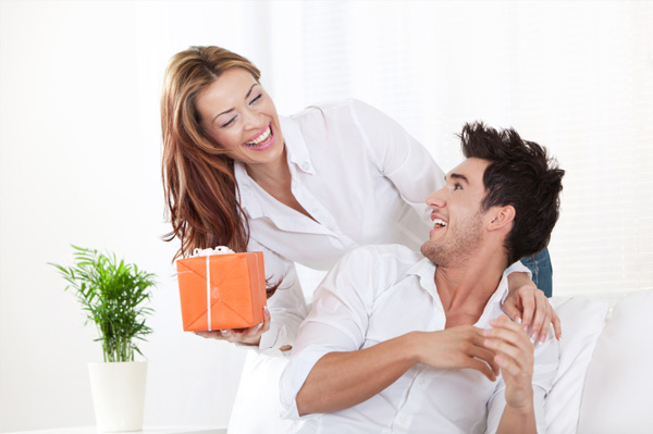 Woman giving gift to husband