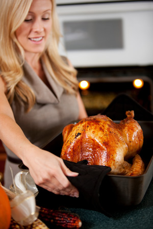 Woman roasting turkey