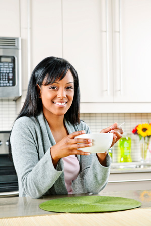 Woman starting day with healthy breakfast