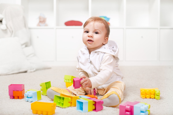 9 month old playing with blocks