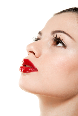 Learn how to pull off a red lip, cat's eye and false lashes