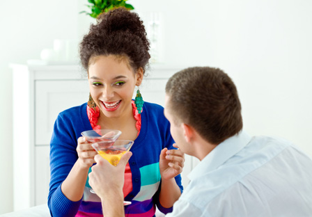 Couple having cocktails at home