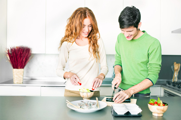 Couple making sushi at home