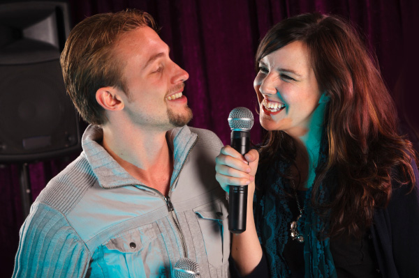 Couple performing karaoke