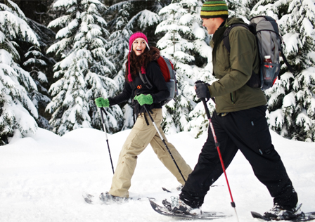 Couple snowshoeing in winter