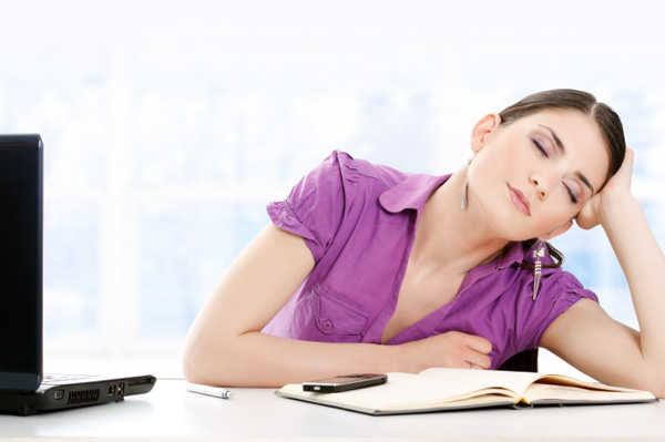 Pregnant woman falling asleep at work