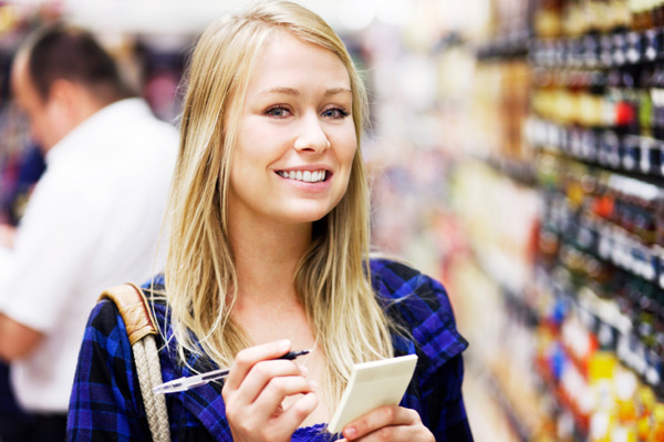Happy woman in supermarket