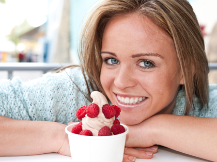 Happy woman with frozen yogurt