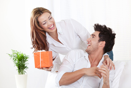 Woman giving boyfriend gift