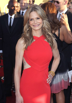 Kyra Sedgwick gets inked for family