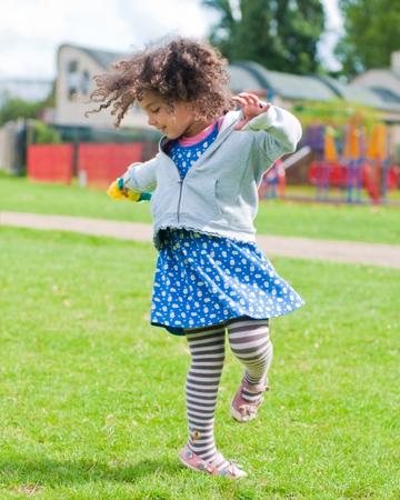 Little girl dancing outside