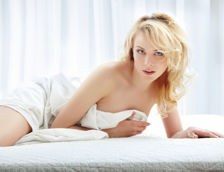 Sexy woman laying in bed. Though we may not be too critical of our partner's ...
