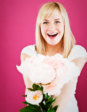 Single woman with flowers on Valentine's Day