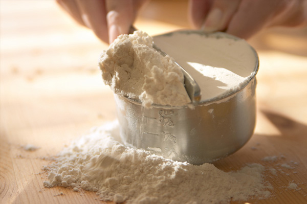 Woman baking with flour