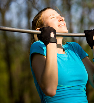 Woman doing chin-ups