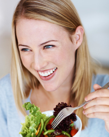 Woman eating healthy garden salad