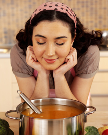 Woman making soup
