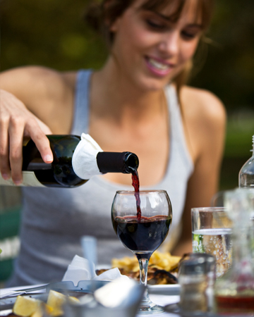 Woman pouring wine