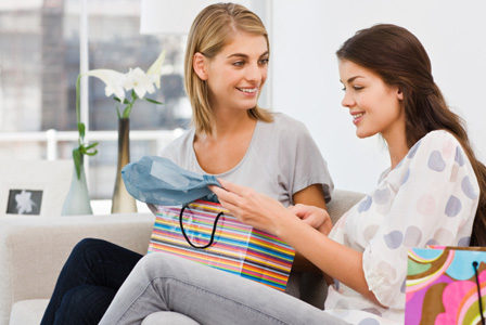 Woman regifting gift to friend