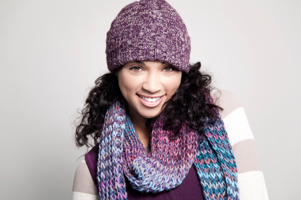 Woman with curly hair wearing knit cap