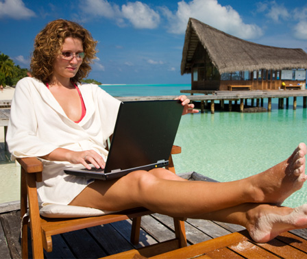 Woman working from beach