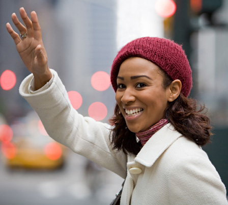 Woman hailing a cab in New York City
