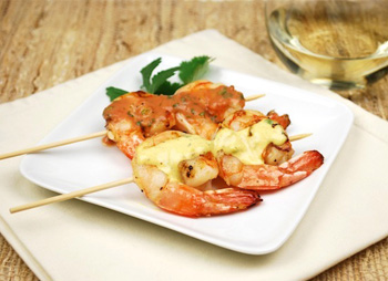 Grilled shrimp cocktail with dipping sauces