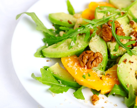 Healthy salad with avocado and walnuts