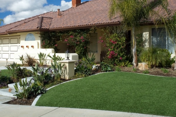 house with an artificial lawn