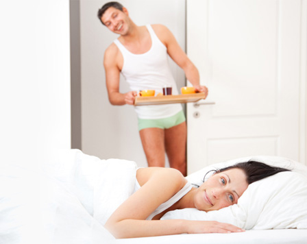Woman being served breakfast in bed