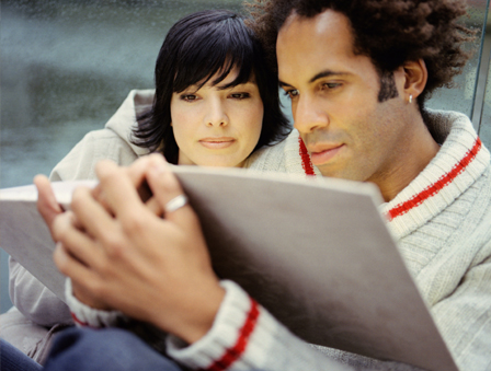 Couple looking at photo book