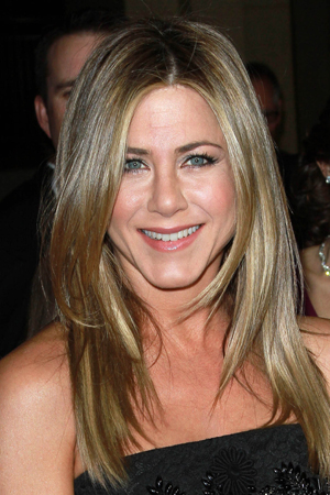 While Jennifer Aniston is simply trying to promote her new movie Wanderlust ...