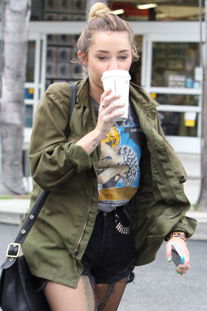 Miley Cyrus (maybe) caught green-handed