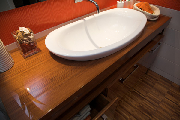 modern looking wood counter bathroom