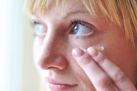 Mom applying eye cream