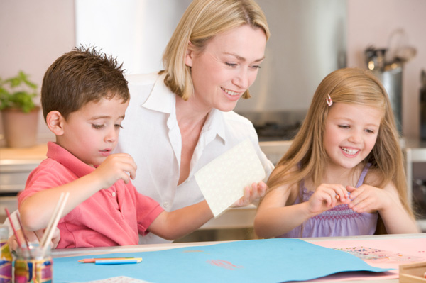 mom and kids doing crafts