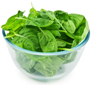 A bowl of fresh green spinach