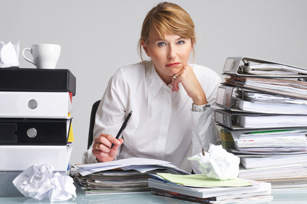 Image result for stressed woman in office